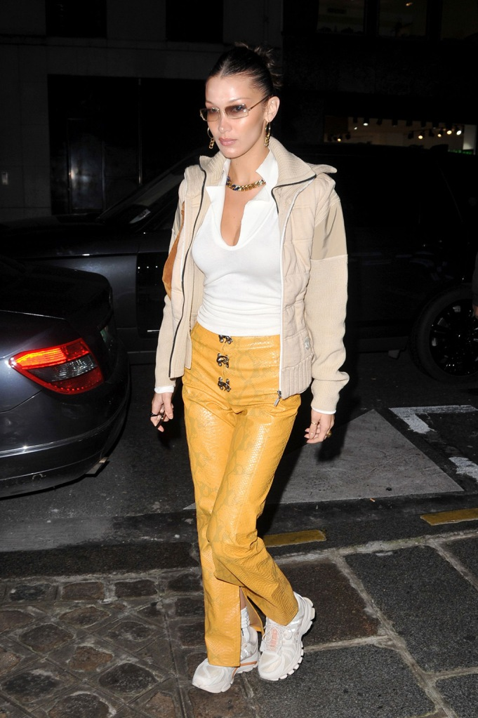 Bella Hadid, celebrity style, li-ning sneakers, snake-print pants, yellow pants, street style, Bella Hadid out and about, Paris, France - 15 Jan 2020Wearing Leo Gaia, Trousers