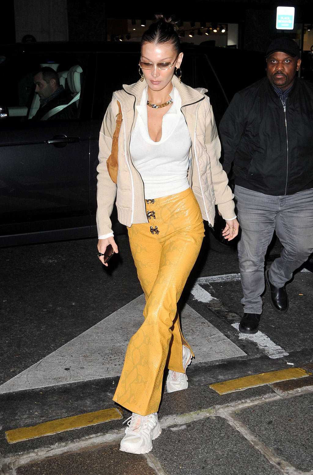 Bella Hadid, celebrity style, li-ning sneakers, snake-print pants, yellow pants, street style, Bella Hadid out and about, Paris, France - 15 Jan 2020Wearing Leo Gaia, TrousersBella HadidBella Hadid out and about, Paris, France - 15 Jan 2020Wearing Leo Gaia, Trousers