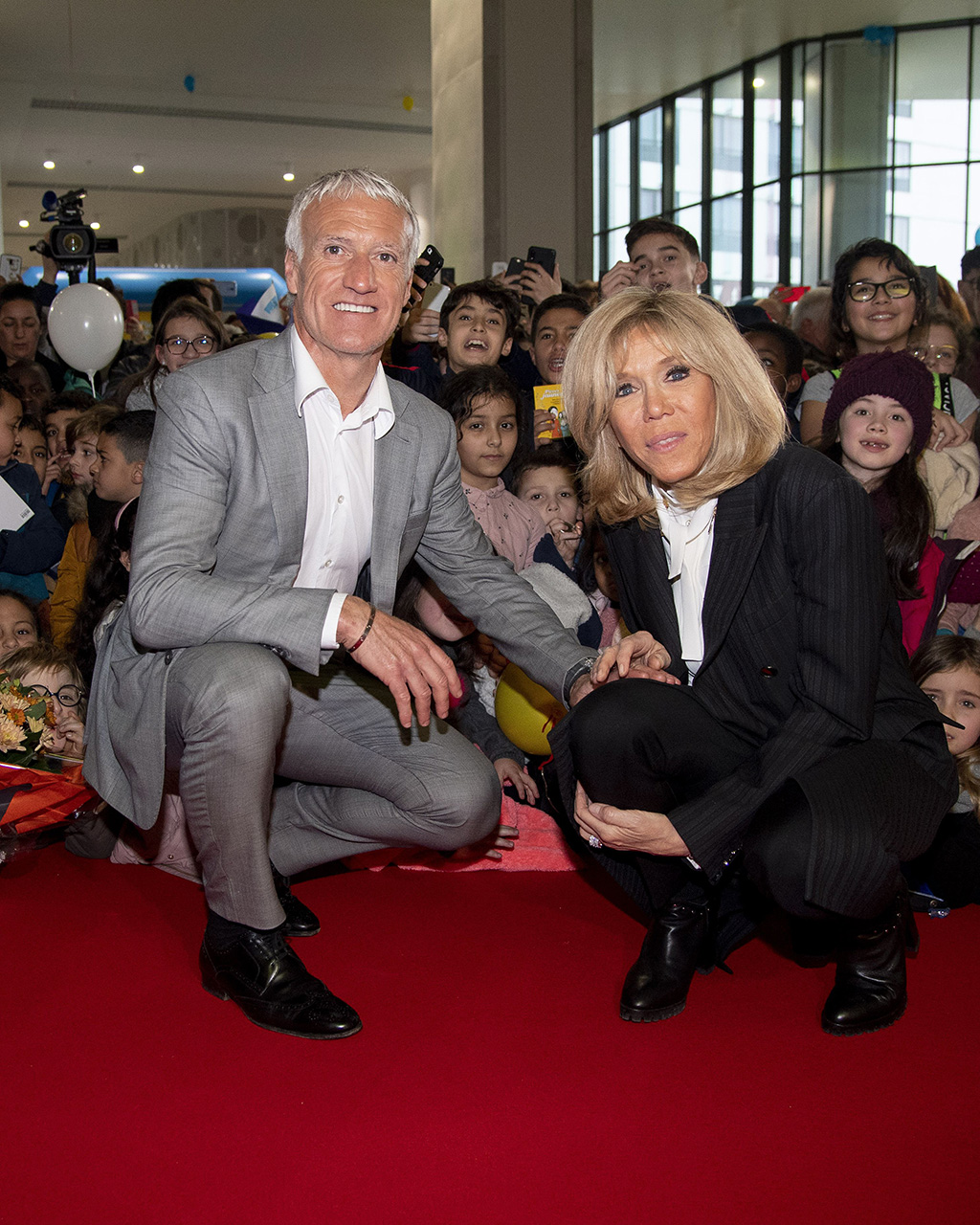 """brigitte macron, black boots, pantsuit, white blouse, French president's wife Brigitte Macron and Didier Deschamps (France former head coach of the French national football team) during the launch of the 31st edition of the """"Pieces Jaunes"""". 08 Jan 2020 Pictured: Brigitte Macron & Didier Deschamps. Photo credit: KCS Presse / MEGA TheMegaAgency.com +1 888 505 6342 (Mega Agency TagID: MEGA581305_002.jpg) [Photo via Mega Agency]French president's wife Brigitte Macron and Didier Deschamps (France former head coach of the French national football team) during the launch of the 31st edition of the """"Pieces Jaunes"""". 08 Jan 2020 Pictured: Brigitte Macron & Didier Deschamps. Photo credit: KCS Presse / MEGA TheMegaAgency.com +1 888 505 6342 (Mega Agency TagID: MEGA581305_021.jpg) [Photo via Mega Agency]"""