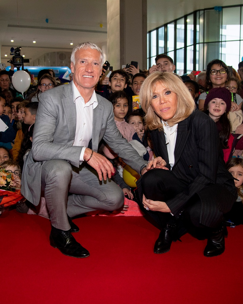 "brigitte macron, black boots, pantsuit, white blouse, French president's wife Brigitte Macron and Didier Deschamps (France former head coach of the French national football team) during the launch of the 31st edition of the ""Pieces Jaunes"". 08 Jan 2020 Pictured: Brigitte Macron & Didier Deschamps. Photo credit: KCS Presse / MEGA TheMegaAgency.com +1 888 505 6342 (Mega Agency TagID: MEGA581305_002.jpg) [Photo via Mega Agency]French president's wife Brigitte Macron and Didier Deschamps (France former head coach of the French national football team) during the launch of the 31st edition of the ""Pieces Jaunes"". 08 Jan 2020 Pictured: Brigitte Macron & Didier Deschamps. Photo credit: KCS Presse / MEGA TheMegaAgency.com +1 888 505 6342 (Mega Agency TagID: MEGA581305_021.jpg) [Photo via Mega Agency]"
