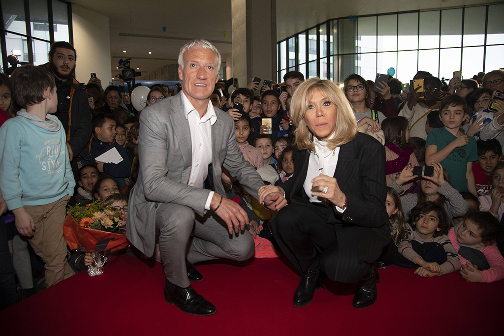 """brigitte macron, black boots, pantsuit, white blouse, French president's wife Brigitte Macron and Didier Deschamps (France former head coach of the French national football team) during the launch of the 31st edition of the """"Pieces Jaunes"""". 08 Jan 2020 Pictured: Brigitte Macron & Didier Deschamps. Photo credit: KCS Presse / MEGA TheMegaAgency.com +1 888 505 6342 (Mega Agency TagID: MEGA581305_002.jpg) [Photo via Mega Agency]"""