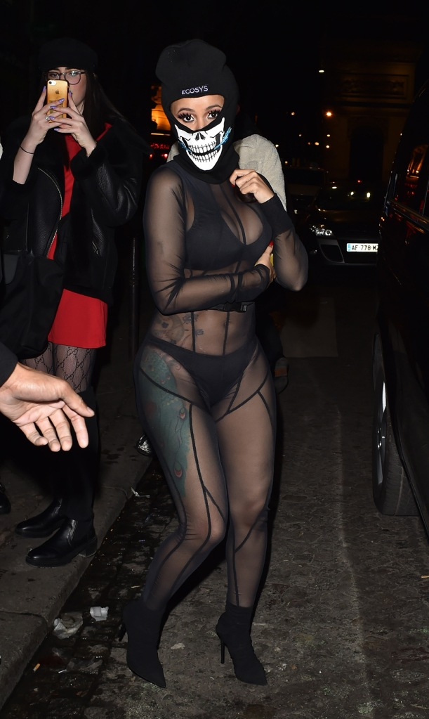 Cardi B, sheer catsuit, abs, stomach, sheer outfit, bra, underwear, tattoos, black ankle boots, is seen with boyfriend Offset at Cesar restaurant in Paris, the couple were then seen going to a clubPictured: Cardi B,OffsetRef: SPL5140761 160120 NON-EXCLUSIVEPicture by: New Media Images / SplashNews.comSplash News and PicturesLos Angeles: 310-821-2666New York: 212-619-2666London: +44 (0)20 7644 7656Berlin: +49 175 3764 166photodesk@splashnews.comWorld Rights