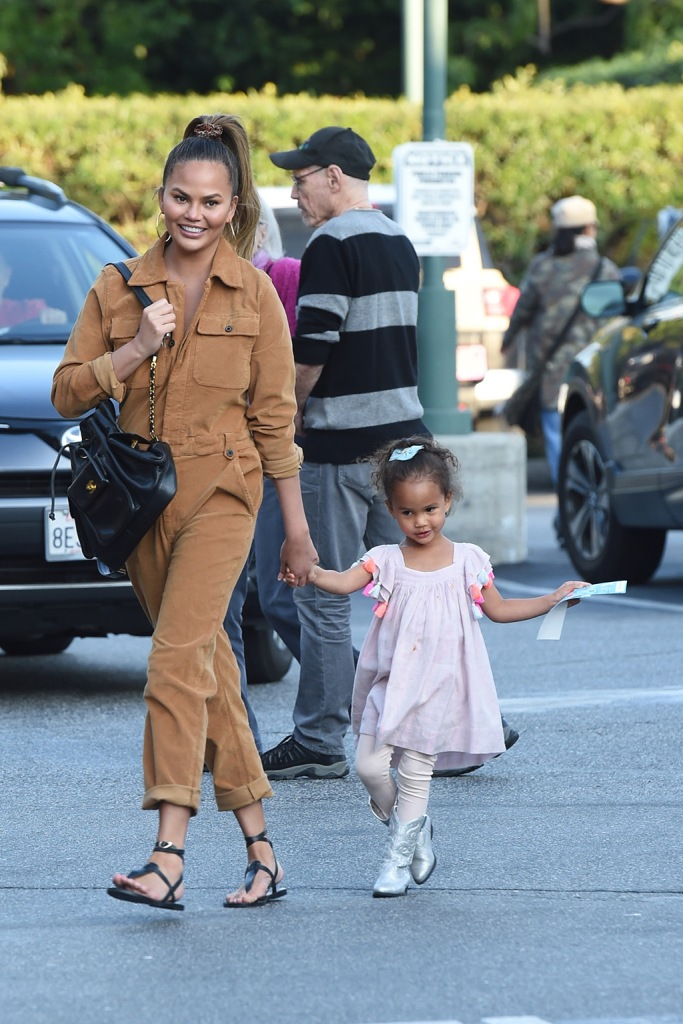 Chrissy Teigen , ancient greek sandals, frame jumpsuit, tan boiler suit, thong sandals, luna, tucker and tate boots, silver boots, and her daughter Luna go grocery shopping at Bristol Farms in Beverly Hills. The 34 year old model is wearing brown/beige overalls. 13 Jan 2020 Pictured: Chrissy Teigen And Luna. Photo credit: Photographer Group/MEGA TheMegaAgency.com +1 888 505 6342 (Mega Agency TagID: MEGA584489_009.jpg) [Photo via Mega Agency]