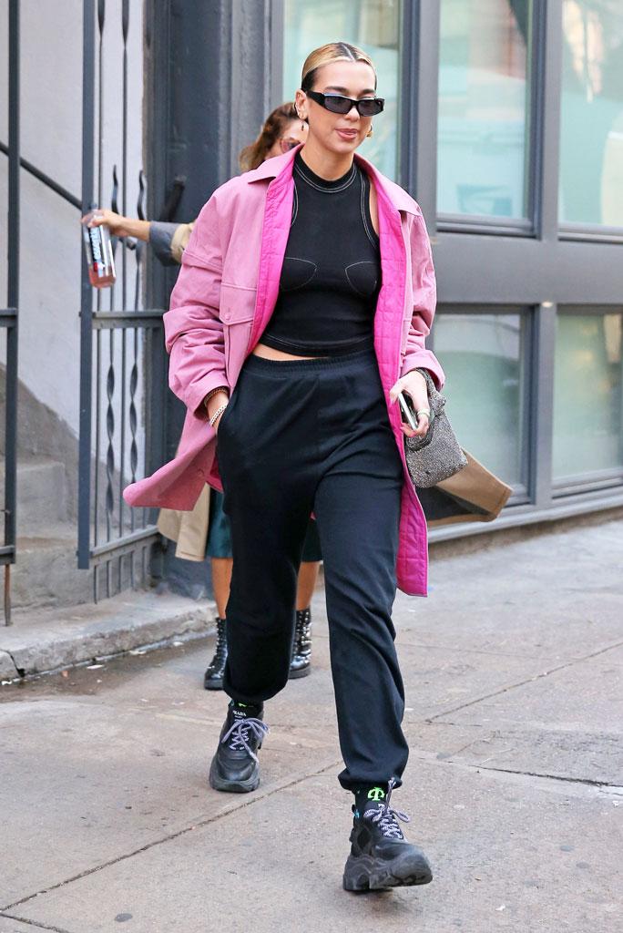 Dua Lipa, pink coat, orseund iris tank top, sweatpants, prada sneakers, chunky sneakers, street style, celebrity style, nyc, january 2020