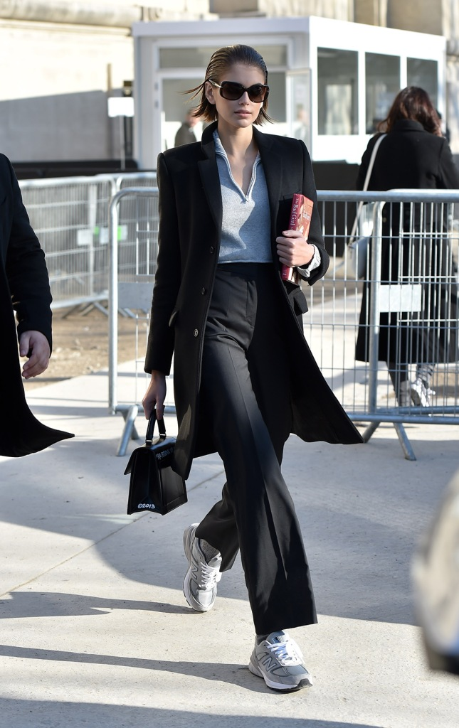 kaia gerber, saint laurent coat, black pants, new balance 990 v5, dad shoes, sneakers, gray shirt, Model Kaia Gerber is seen looking stylish as she arrives at the Chanel fashion show in Paris, France.Pictured: Kaia GerberRef: SPL5141828 210120 NON-EXCLUSIVEPicture by: New Media Images / SplashNews.comSplash News and PicturesLos Angeles: 310-821-2666New York: 212-619-2666London: +44 (0)20 7644 7656Berlin: +49 175 3764 166photodesk@splashnews.comWorld Rights