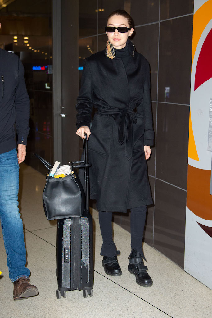 Gigi Hadid arrives at JFK airport in NYC. Pictured: Gigi Hadid Ref: SPL5142785 240120 NON-EXCLUSIVE Picture by: SplashNews.com Splash News and Pictures Los Angeles: 310-821-2666 New York: 212-619-2666 London: +44 (0)20 7644 7656 Berlin: +49 175 3764 166 photodesk@splashnews.com World Rights
