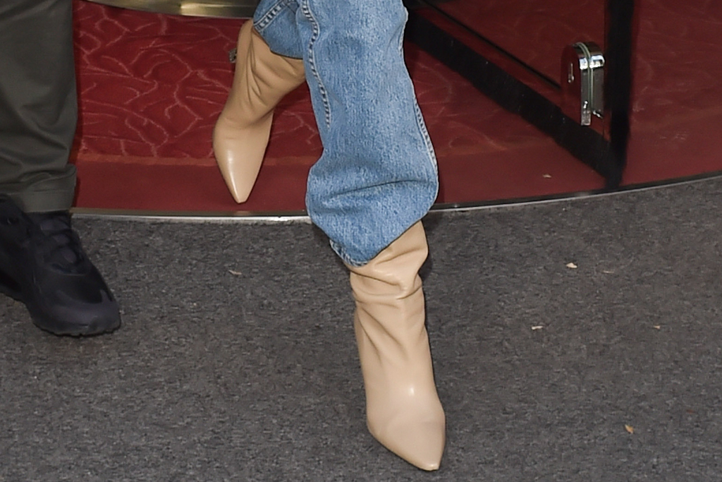 gigi hadid, paris, graphic sweater, jeans, boots