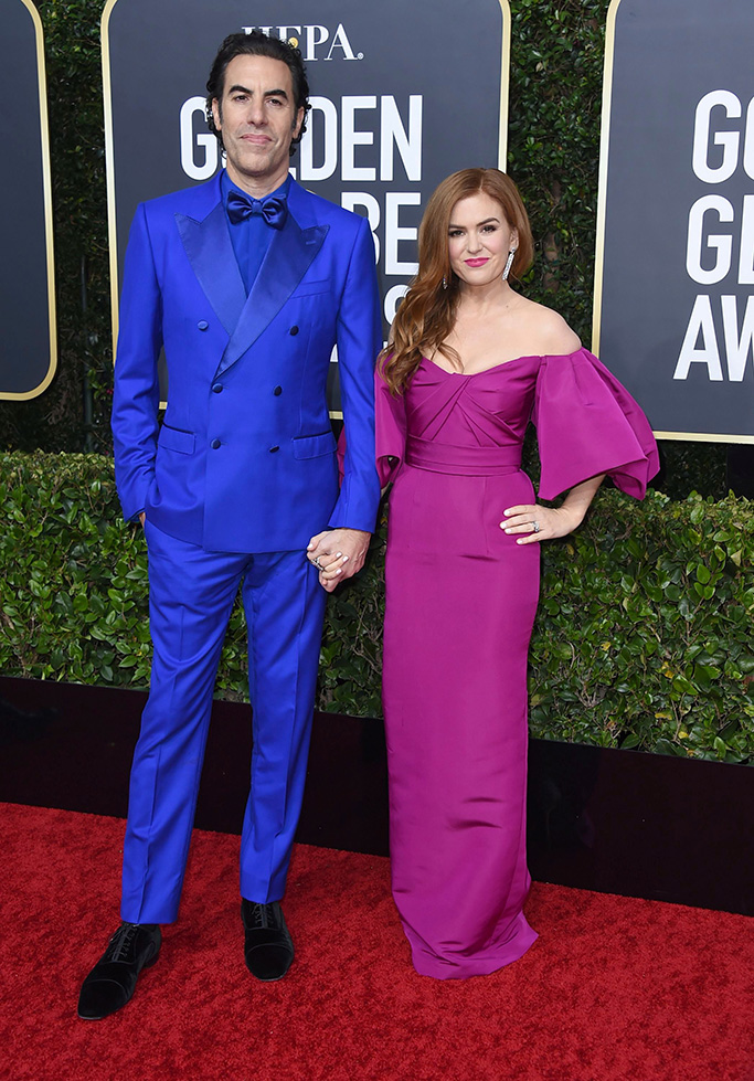 isla fisher, monique lhullier, pink gown, blue suit, Sacha Baron Cohen, Isla Fisher. Sacha Baron Cohen, left, and Isla Fisher arrive at the 77th annual Golden Globe Awards at the Beverly Hilton Hotel, in Beverly Hills, Calif77th Annual Golden Globe Awards - Arrivals, Beverly Hills, USA - 05 Jan 2020
