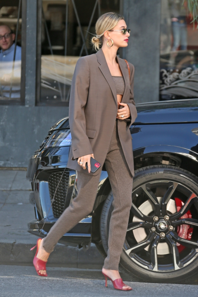 Hailey Baldwin, hailey bieber, street style, celebrity fashion, january 2020, bottega veneta blazer, Mandkhai crop top, Mandkhai pants, red shoes, square toe trend,