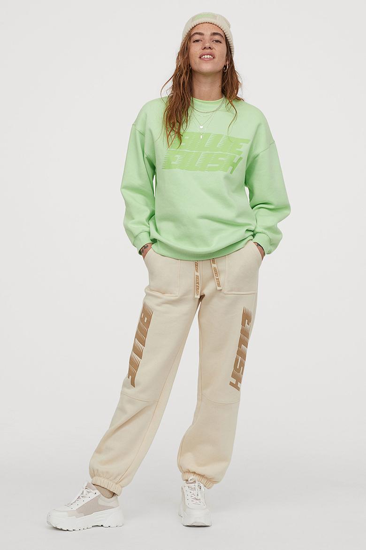 H&M x Billie Eilish, billie eilish, rib-knit hat, sweatshirt, oversized joggers and knit socks.