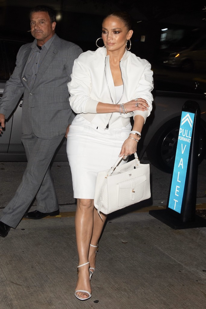 """Jennifer Lopez looks chic in all-white as she goes for dinner in South Beach - before a cake was dropped on her lap. The singer, who is in final preparations for her high profile Superbowl half-time performance, showed off her incredible shape in a revealing outfit as she hit up one of Miami Beach's hottest new restaurants, Papi Steak, with Alex Rodriguez. The pair were celebrating her manager Benny Medina's birthday and looked on with excitement as a six-tier cake was brought out for him and placed on a table just in front of them. But J Lo for once will have wished she wasn't in the front row. Soon after everyone had done their speeches and Instagram videos, a waiter accidentally spilled some of the cake on the singer's lap. But she was no diva about it. """"There was a stunned silence for a second, but fortunately she just laughed it off,"""" said a source. """"Jlo an Arod were both very nice about it and tried to defend the waiter as it was just an accident. She was very sweet about the whole situation. She said something like - 'at least I didn't pay for this jacket'."""". 24 Jan 2020 Pictured: Jennifer Lopez and A-Rod. Photo credit: MEGA TheMegaAgency.com +1 888 505 6342 (Mega Agency TagID: MEGA593302_001.jpg) [Photo via Mega Agency]"""