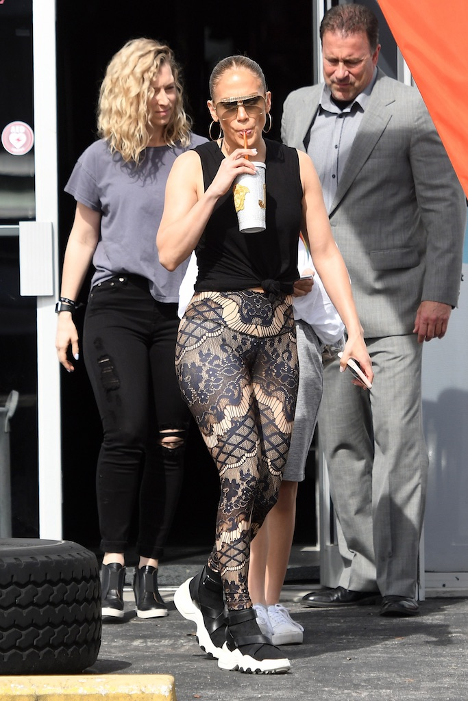 EXCLUSIVE: Jennifer Lopez wears unique lace patterned leggings as she hits the gym with boyfriend Alex Rodriguez in Miami. Her mini-me daughter, Emma, was along for the trip, and the group was also seen heading to the Hard Rock Stadium, where J-Lo will perform at the Super Bowl Halftime Show. 24 Jan 2020 Pictured: Jennifer Lopez; Alex Rodriguez. Photo credit: MEGA TheMegaAgency.com +1 888 505 6342 (Mega Agency TagID: MEGA592979_001.jpg) [Photo via Mega Agency]