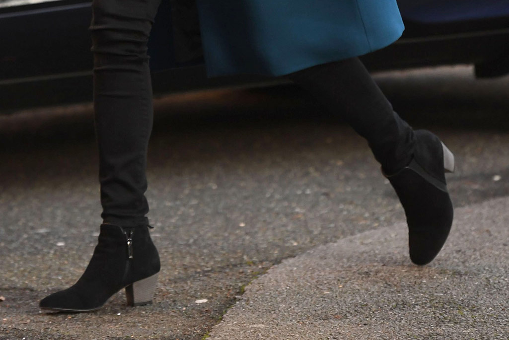 Kate Middleton attends the London Early Years Foundation nursery in South London wearing Russell & Bromley boots and a teal blue coat.