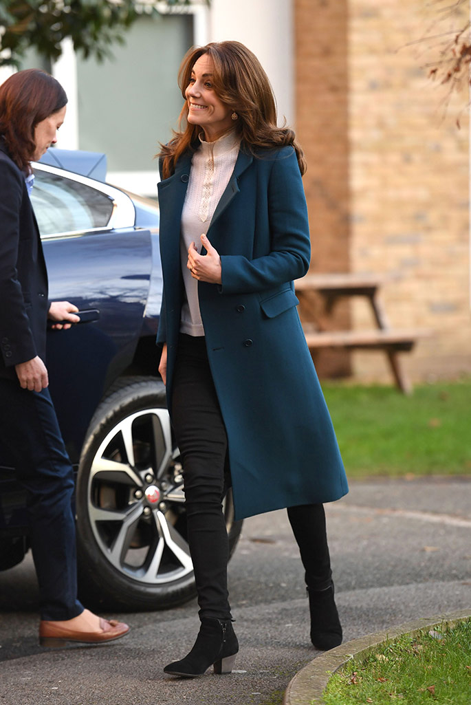 Kate Middleton attends the London Early Years Foundation nursery in South London wearing Russell & Bromley boots, Sezane top and a teal blue coat.