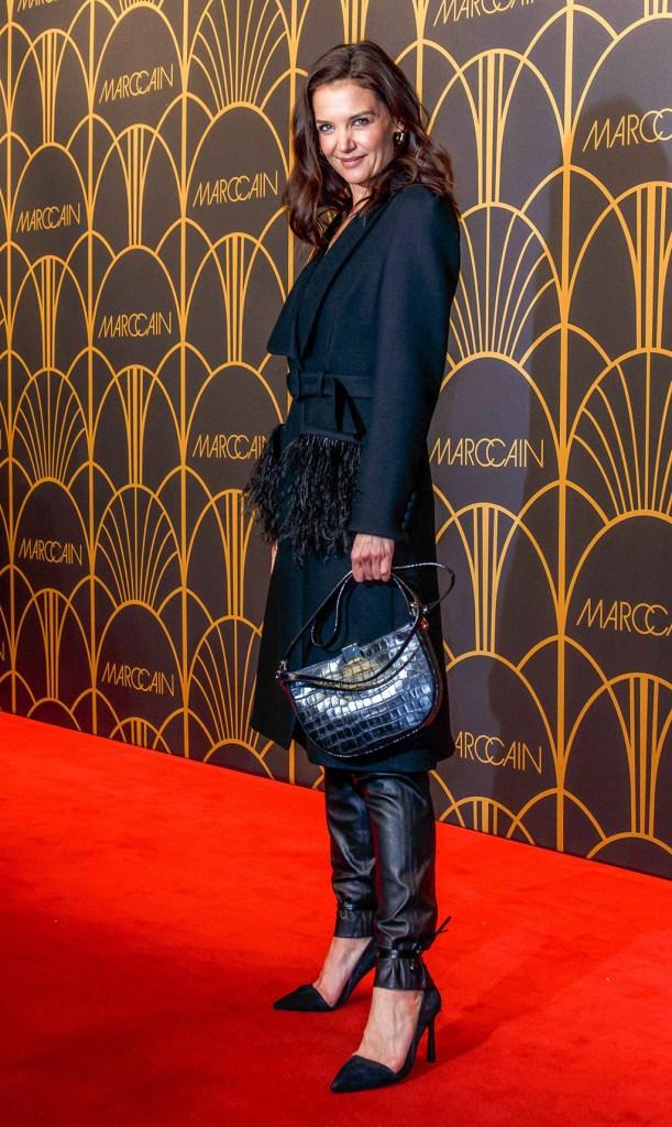 Katie Holmes, stilettos, black pointy toe pumps, belted coat, croc print handbag, leather pants, Marc Cain show, Arrivals, Mercedes-Benz Fashion Week, Berlin, Germany - 14 Jan 2020