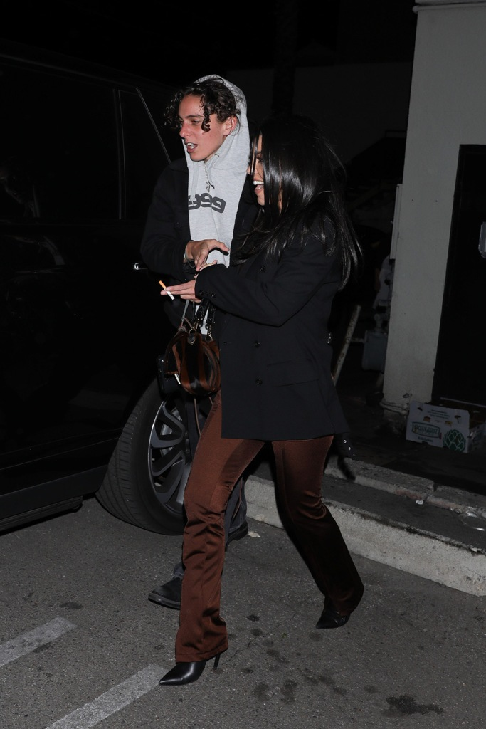 Kourtney Kardashian, black blazer, pointy toe boots, stiletto, brown jumpsuit, is seen leaving with friends after dinner at Matsuhisa including Suki Waterhouse and her date. 08 Jan 2020 Pictured: Kourtney Kardashian. Photo credit: MEGA TheMegaAgency.com +1 888 505 6342 (Mega Agency TagID: MEGA581051_006.jpg) [Photo via Mega Agency]