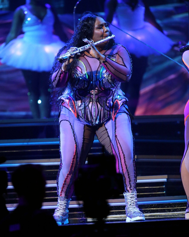 lizzo, on stage, performance, grammy awards, glittering combat boots