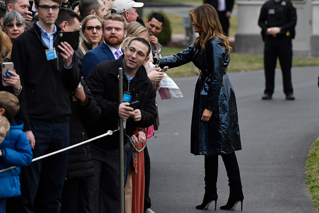flotus, melania trump, stilettos, black boots, prada shoes, blue coat, marc jacobs coat, metallic, First lady Melania Trump greets people before she and President Donald Trump board Marine One on the South Lawn of the White House in Washington, . The Trumps are heading to New Orleans to attend the College Football Playoff National Championship between Louisiana State University and ClemsonTrump, Washington, USA - 13 Jan 2020