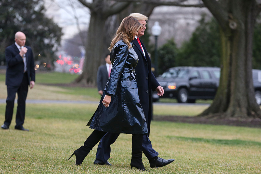 melania trump, flotus, metallic blue coat, black boots, stilettos, celebrity style, US President Donald J. Trump and first lady Melania Trump walk on the South Lawn of the White House before boarding Marine One, in Washington, DC, USA, 13 January 2020. President Trump and first lady will attend the College Football Playoff National Championship in New Orleans, LA.President Trump will attend the College Football Playoff National Championship, Washington, Usa - 13 Jan 2020