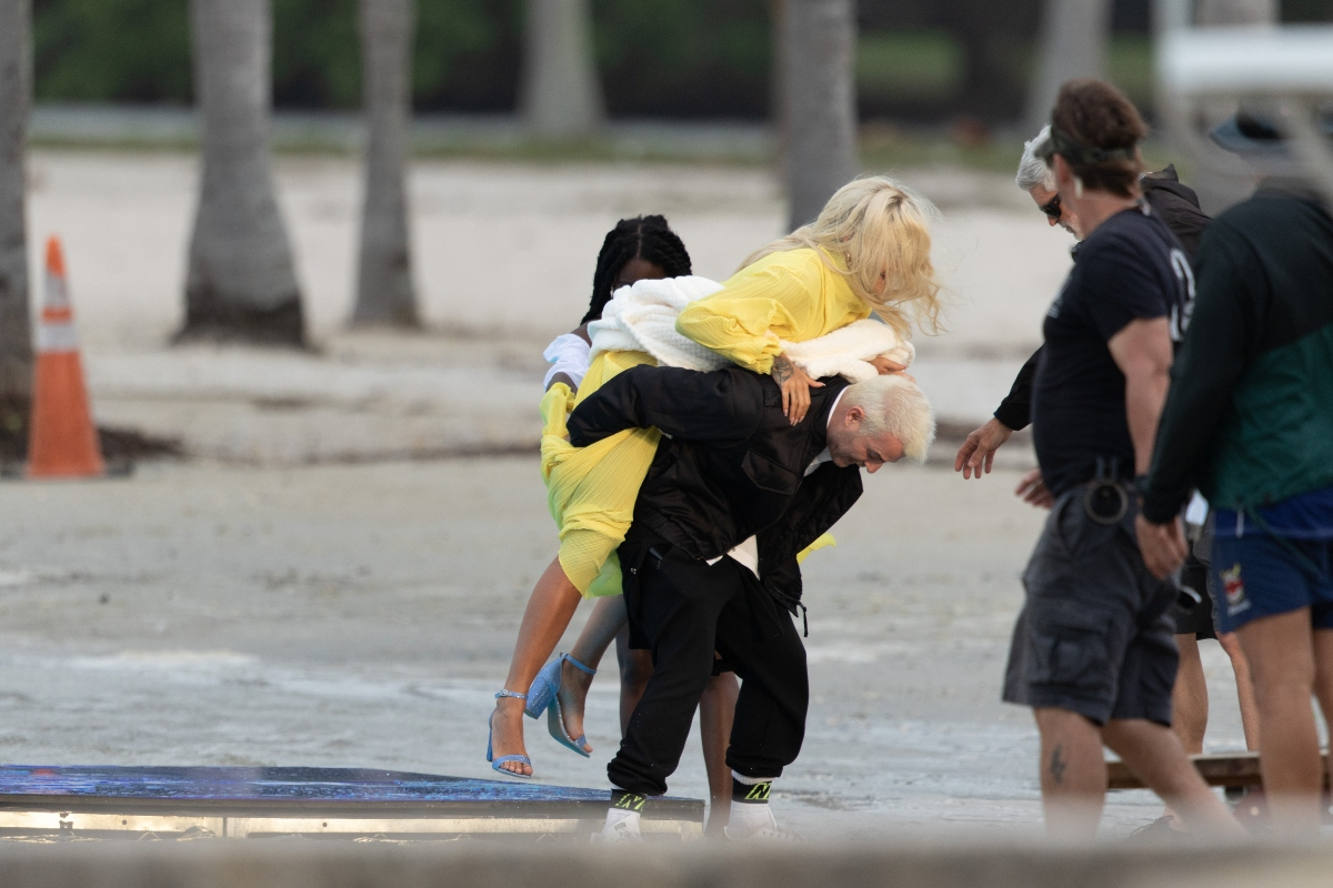 rita ora, miami, music video, yellow dress, blue heels, beach, piggyback