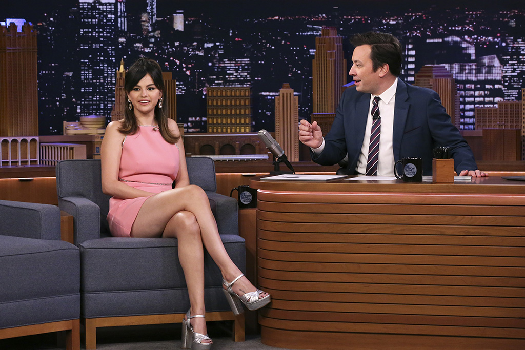 selena gomez, pink minidress, miu miu dress, prada sandals, platform sandals, celebrity style, THE TONIGHT SHOW STARRING JIMMY FALLON -- Episode 1186 -- Pictured: (l-r) Actress Selena Gomez during an interview with host Jimmy Fallon on January 13, 2020 -- (Photo by: Andrew Lipovsky/NBC)