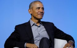 Former U.S. President Barack Obama smiles