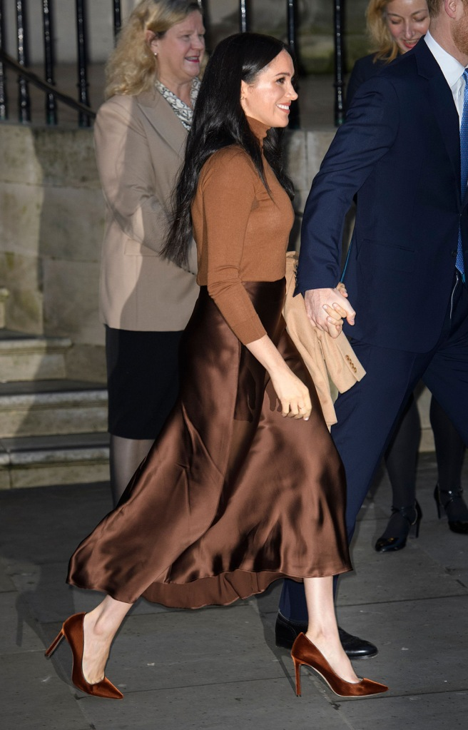 meghan markle, tan coat, stella mccartney coat, brown skirt, jimmy choo romy pumps, velvet pumps, stilettos, street style, 2020, Prince Harry and Meghan Duchess of SussexPrince Harry and Meghan Duchess of Sussex visit to Canada House, London, UK - 07 Jan 2020Their Royal Highnesses wanted to meet with HE. Ms. Janice Charette, High Commissioner in Canada to the UK as well as staff to thank them for the warm Canadian hospitality and support they received during their recent stay in Canada. Following their meeting with the High Commissioner, Their Royal Highnesses will visit the Canada Gallery and view a special exhibition by Indigenous Canadian artist, Skawennati. The Duke and Duchess of Sussex will also meet different members of the High Commission team who work in a range of sectors supporting the partnership between Canada and the UK. The Duke and Duchess of Sussex last visited Canada House on Commonwealth Day in March 2019 where they met and spoke with young Canadians from a wide range of sectors including fashion, the arts, and business and academia, about their experiences as expats as well as opportunities for young people working in the Commonwealth., brown outfit, Meghan Duchess of Sussex and Prince HarryPrince Harry and Meghan Duchess of Sussex visit to Canada House, London, UK - 07 Jan 2020Their Royal Highnesses wanted to meet with HE. Ms. Janice Charette, High Commissioner in Canada to the UK as well as staff to thank them for the warm Canadian hospitality and support they received during their recent stay in Canada. Following their meeting with the High Commissioner, Their Royal Highnesses will visit the Canada Gallery and view a special exhibition by Indigenous Canadian artist, Skawennati. The Duke and Duchess of Sussex will also meet different members of the High Commission team who work in a range of sectors supporting the partnership between Canada and the UK. The Duke and Duchess of Sussex last visited Canada House on Commonwealth Day in March 2019 where they met and spoke with young Canadians from a wide range of sectors including fashion, the arts, and business and academia, about their experiences as expats as well as opportunities for young people working in the Commonwealth.