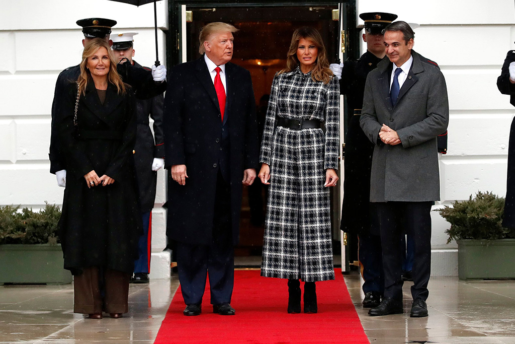 melania trump, plaid jumpsuit, celebrity style, black boots, white house, President Donald Trump, accompanied by first lady Melania Trump, welcome Greek Prime Minister Kyriakos Mitsotakis and his wife Mareva Grabowski-Mitsotakis as they arrive on the South Lawn of the White House, in WashingtonTrump, Washington, USA - 07 Jan 2020