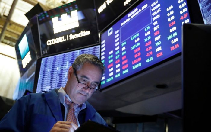 Trader Daniel Trimble works on the floor of the New York Stock Exchange, . Stocks are opening broadly higher on Wall Street as traders welcome news that China's top trade official will head to Washington next week to sign a preliminary trade deal with the U.SFinancial Markets Wall Street, New York, USA - 09 Jan 2020