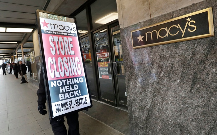 """Raymond Martin walks with a """"store closing"""" sign on his back in front of the Macy's store in downtown Seattle. The store is one of nearly 30 Macy's stores to be closed nationwide in the coming weeksMacys Closing, Seattle, USA - 09 Jan 2020"""