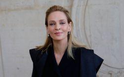 Actress Uma Thurman poses before Dior