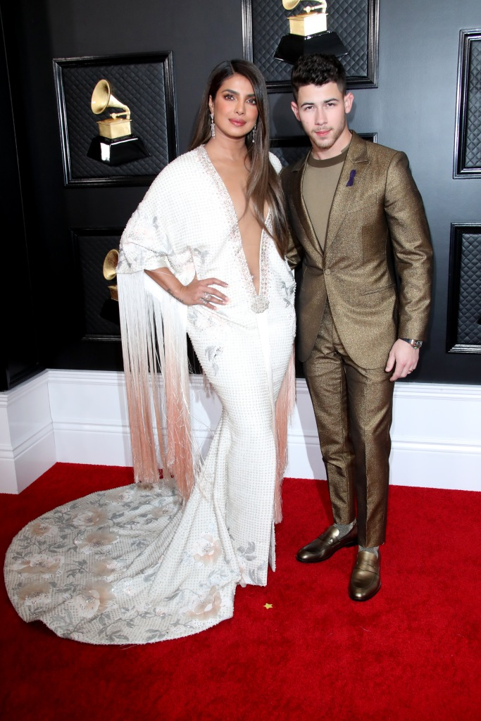 Priyanka Chopra, ralph and russo, plunging gown, belly ring, nick jonas, zegna, and Nick Jonas62nd Annual Grammy Awards, Arrivals, Los Angeles, USA - 26 Jan 2020