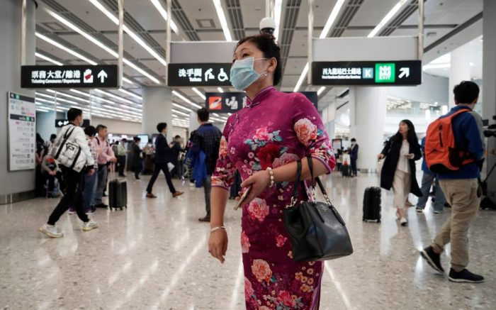 A passenger wears a protective face mask at the departure hall of the high speed train station in Hong Kong, . China closed off a city of more than 11 million people Thursday, halting transportation and warning against public gatherings, to try to stop the spread of a deadly new virus that has sickened hundreds and spread to other cities and countries in the Lunar New Year travel rushChina Outbreak, Hong Kong, Hong Kong - 23 Jan 2020