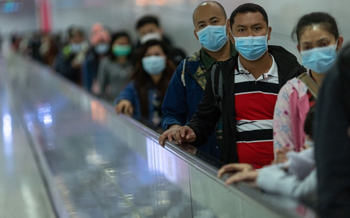 Commuters wear face masks in the Mass Transit Railway (MTR) in Hong Kong, China, 26 January 2020. Hong Kong has confirmed a sixth case of the Wuhan coronavirus.Hong Kong confirms sixth case of Wuhan virus, China - 26 Jan 2020