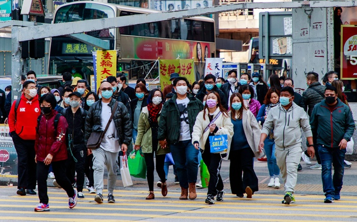 Hong Kongers wear face masks cross a road in Hong Kong.Coronavirus outbreak, Hong Kong, China - 28 Jan 2020