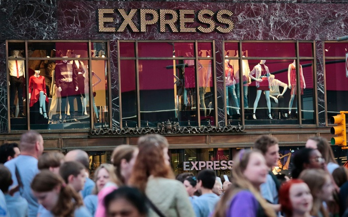 Express People walk by an Express store in New York's Times Square, . A fashion overhaul helped Express lure more customers to its stores and the clothing chain reported better-than-expected earnings for the fourth quarterEarns Express