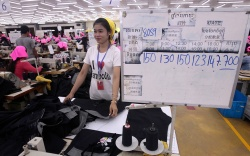 A Cambodian garment worker is seen