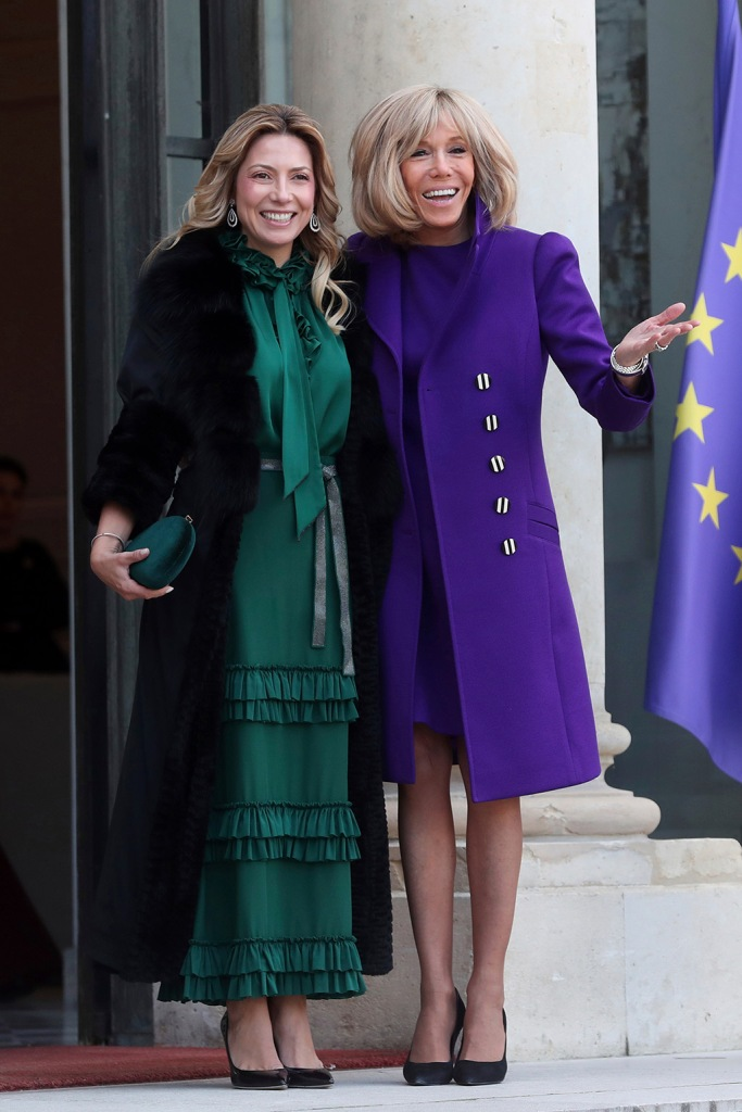 brigitte marcon, purple dress, coat, black pumps, French President Emmanuel Macron's wife Brigitte Macron, right, welcomes Fabiola Yanez, partner of Argentina's President Alberto Fernandez, at the Elysee Palace, in ParisArgentina, Paris, France - 05 Feb 2020
