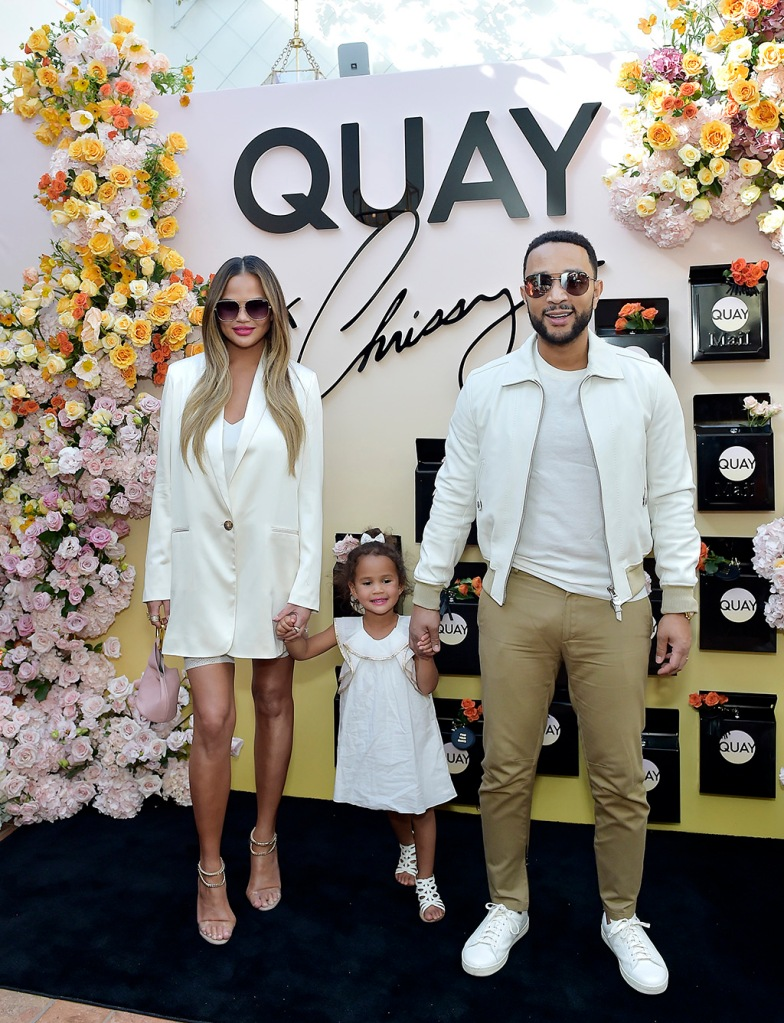 Chrissy Teigen, white minidress, white blazer dress, alevi valentino sandals, john legend, white sneakers, luna stephens, sandals, white dress, WEST HOLLYWOOD, CALIFORNIA - FEBRUARY 11: Chrissy Teigen and daughter attend QUAYXCHRISSY Launch Party at Olivetta on February 11, 2020 in West Hollywood, California. (Photo by Stefanie Keenan/Getty Images for Quay )