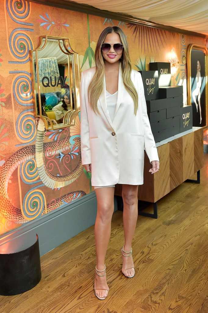 Chrissy Teigen, white minidress, white blazer dress, alevi valentino sandals, WEST HOLLYWOOD, CALIFORNIA - FEBRUARY 11: Chrissy Teigen attends QUAYXCHRISSY Launch Party at Olivetta on February 11, 2020 in West Hollywood, California. (Photo by Stefanie Keenan/Getty Images for Quay )