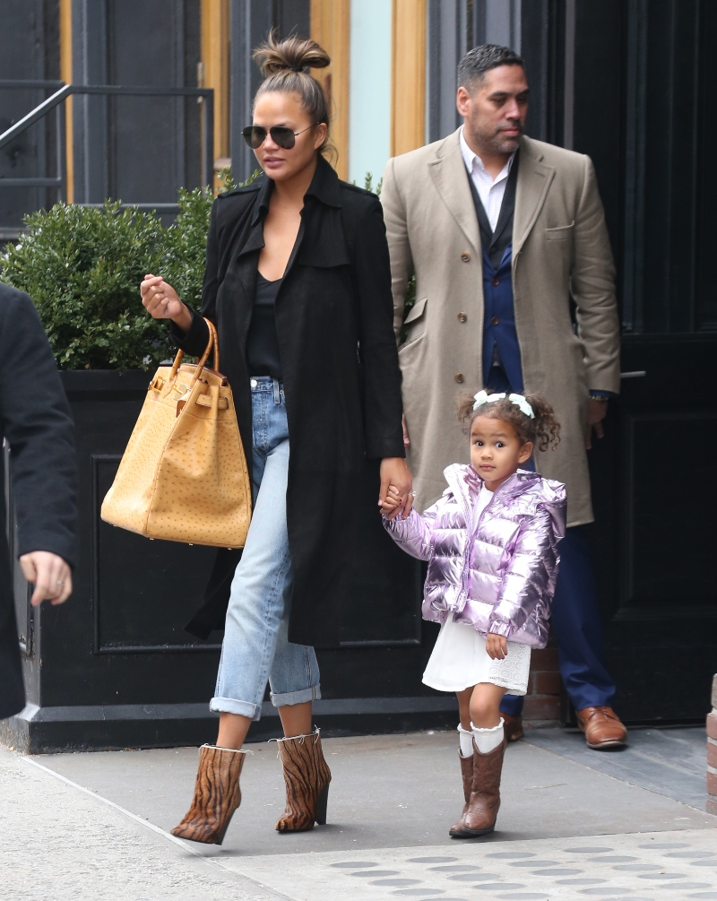 chrissy teigen, luna, western boots, tiger boots, birkin, purple jacket, jeans, yellow bag, nyc, new york
