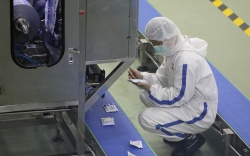 Workers wearing protective masks at a