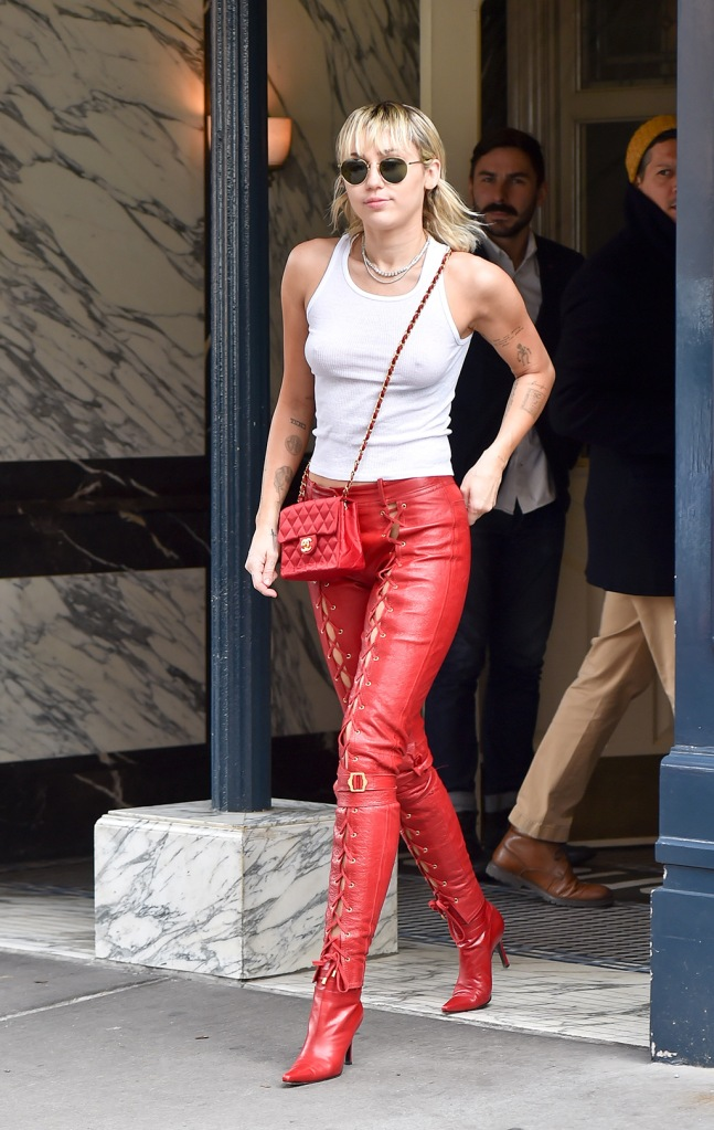 Miley Cyrus, red lace-up pants, skinny leather pants, white tank top, red ankle boots, street style, celebrity style, looks hot in Red Leather trousers and a white top with no bra as she makes her way to Marc Jacobs fashion show in New YorkPictured: Miley CyrusRef: SPL5148346 120220 NON-EXCLUSIVEPicture by: New Media Images / SplashNews.comSplash News and PicturesLos Angeles: 310-821-2666New York: 212-619-2666London: +44 (0)20 7644 7656Berlin: +49 175 3764 166photodesk@splashnews.comWorld RightsMiley Cyrus looks hot in Red Leather trousers and a white top with no bra as she makes her way to Marc Jacobs fashion show in New YorkPictured: Miley CyrusRef: SPL5148346 120220 NON-EXCLUSIVEPicture by: New Media Images / SplashNews.comSplash News and PicturesLos Angeles: 310-821-2666New York: 212-619-2666London: +44 (0)20 7644 7656Berlin: +49 175 3764 166photodesk@splashnews.comWorld Rights