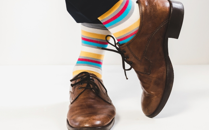 Men's feet in stylish shoes and funny socks; Shutterstock ID 1010794885; Usage (Print, Web, Both): Web; Issue Date: 2/3