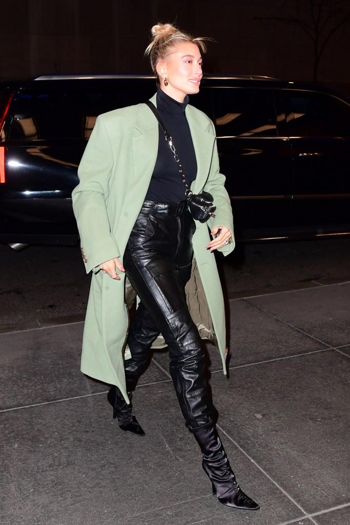Hailey Baldwin , martine rose coat, danielle guizio pants, leather pants, alexander wang boots, satin boots, wolford top, jennifer fisher hoop earrings, , street style, nyc, snl