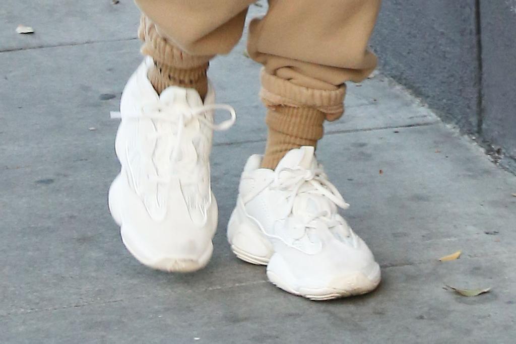 Hailey Baldwin, yeezy 500 bone white, white sneakers, yeezys, shoe detail