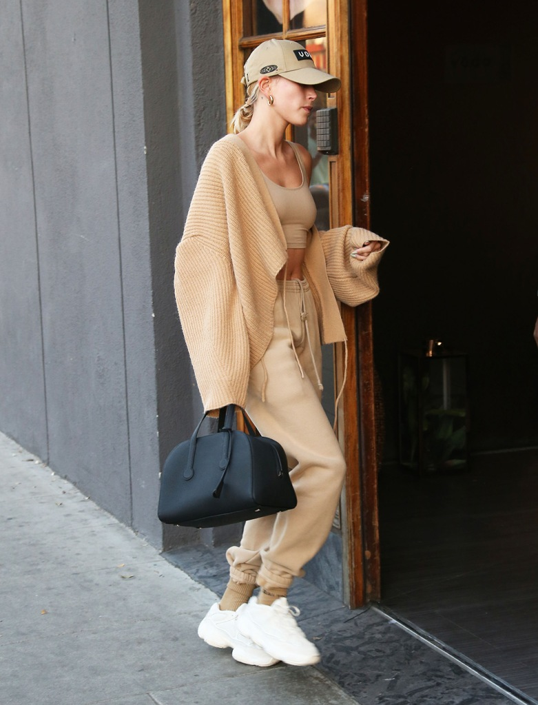 hailey baldwin, cardigan, crop top, abs, yeezy 500 bone white, yeezy sneakers, the row bag, dad hat, sweats, sweatpants, Hailey BieberHailey Bieber out and about, Los Angeles, USA - 17 Feb 2020Hailey Bieber meets up with husband Justin Bieber at SpaHailey BieberHailey Bieber out and about, Los Angeles, USA - 17 Feb 2020Hailey Bieber meets up with husband Justin Bieber at Spa
