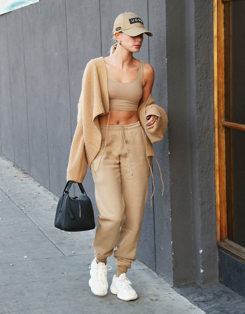 hailey baldwin, cardigan, crop top, abs, yeezy 500 bone white, yeezy sneakers, the row bag, dad hat, sweats, sweatpants, Hailey BieberHailey Bieber out and about, Los Angeles, USA - 17 Feb 2020Hailey Bieber meets up with husband Justin Bieber at Spa