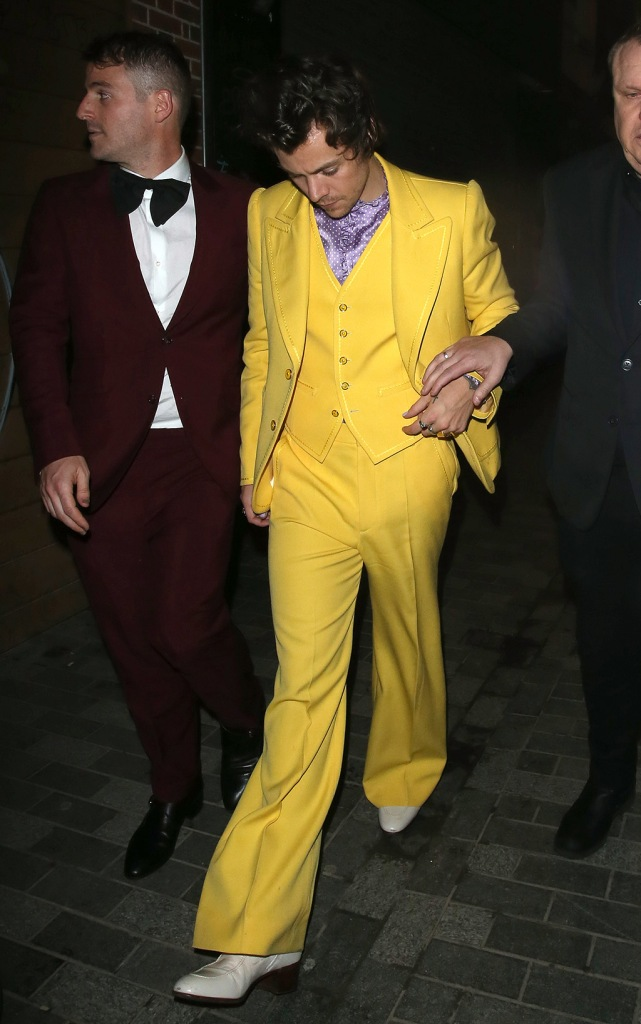 Harry Styles, yellow pantsuit, marc jacobs suit, white boots, celebrity style, purple shirt, partying at The Box Night Club in Soho, London until 2.20am after The 2020 Brit Awards.Harry was partying at The Soho night club along with Kendall Jenner, Lizzo & Naomi Campbell.Harry was wearing a bright yellow suit similar to those worn in the movies by The Mask & The Joker in Batman.Pictured: Harry StylesRef: SPL5149977 190220 NON-EXCLUSIVEPicture by: WP Pix / SplashNews.comSplash News and PicturesLos Angeles: 310-821-2666New York: 212-619-2666London: +44 (0)20 7644 7656Berlin: +49 175 3764 166photodesk@splashnews.comWorld Rights