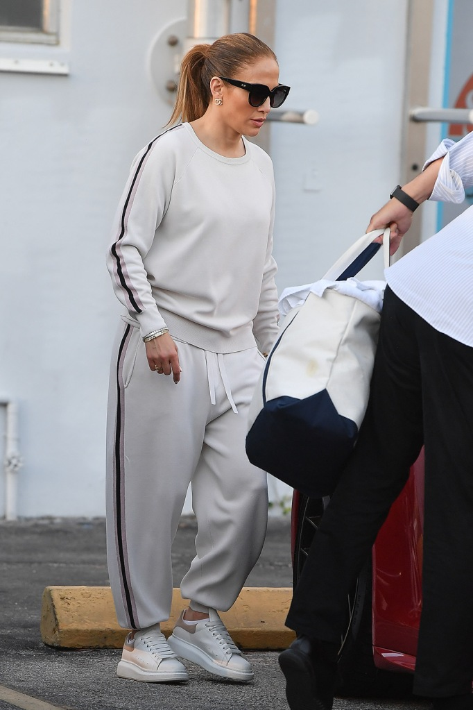 Jennifer Lopez, Olivia Von Halle missy moscow sweater, sweatpants, j-lo, alexander mcqueen oversize sole sneakers, and Alex Rodriguez leave the gym in Miami,FloridaPictured: Jennifer LopezRef: SPL5151110 230220 NON-EXCLUSIVEPicture by: Robert O'Neil / SplashNews.comSplash News and PicturesLos Angeles: 310-821-2666New York: 212-619-2666London: +44 (0)20 7644 7656Berlin: +49 175 3764 166photodesk@splashnews.comWorld Rights